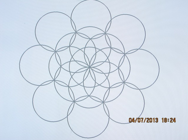 This represents the collective consciousness of Gaia. The flower doesn't touch the center circle, it falls a little short.Go back and look at how the flower touches the center circle perfectly in the perfect Universe scenario.  We are not in harmony with the Universe yet, but we will be in time